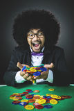 Happy Afro man holds gambling chips Royalty Free Stock Image