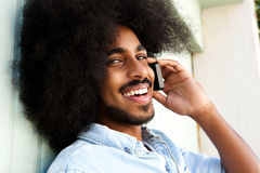 Happy afro man talking on mobile phone and smiling Royalty Free Stock Image