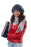 Happy afro woman at wintertime Stock Photos