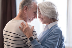 Happy aged couple dancing at home Royalty Free Stock Photography