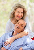 Happy aged couple hugging each other Royalty Free Stock Photos