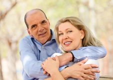 Happy aged lovers hugging each other Royalty Free Stock Image
