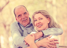 Happy aged lovers hugging each other Royalty Free Stock Photo