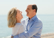 Happy aged lovers laughting outdoor Stock Image