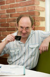 Happy aged man with coffee Royalty Free Stock Photography