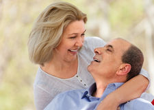 Happy aged man and woman hugging each other Royalty Free Stock Photos