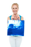 Happy aged woman carrying shopping bag. Looking at camera Royalty Free Stock Photo