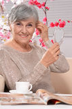 Happy aged woman drinking coffee Royalty Free Stock Photography