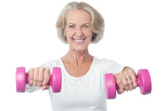 Happy aged woman exercising royalty free stock photo