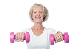 Happy aged woman exercising Stock Images