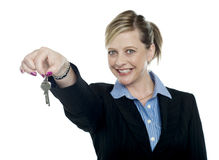 Happy aged woman holding keys royalty free stock photography
