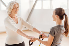 Happy aged woman holding a resistance band Stock Image