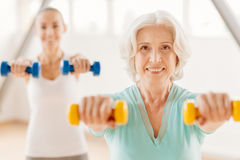 Happy aged woman looking at you Stock Photography