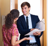 Happy agent with documents Royalty Free Stock Photos