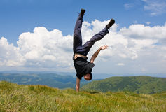 Happy agile man in mountains Royalty Free Stock Images