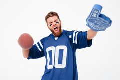 Happy agitated man with fan toys looking camera. Happy agitated bearded man with painted face holding fan toys and looking camera  over white Stock Image
