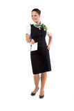 Happy air hostess holding ticket Stock Photo