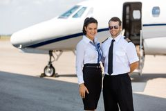 Happy Airhostess And Pilot Standing Against Royalty Free Stock Image