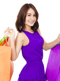 Happy aisan young woman holding shopping bags Royalty Free Stock Image