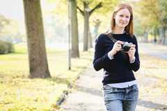 Happy Amateur Photographer in a Park Stock Photography