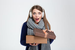 Happy amazed woman holding gift box Royalty Free Stock Image