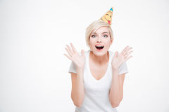 Happy amazed woman in party hat looking at camera Stock Photos
