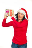Happy amazed woman with Xmas gift Royalty Free Stock Photos