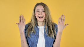 Happy Amazed Young Pretty Girl Surprised by Gift on Yellow Background stock video footage