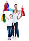 Happy american family with child holding shopping bags stock photography