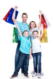 Happy american family with children holding shopping bags Royalty Free Stock Images