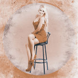 Happy american style pin-up girl on retro chair Stock Photography