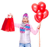 Happy american woman with red shopping bags  and balloons. Isolated on white background Royalty Free Stock Photos