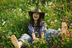 Happy American woman in wild flowers Stock Images