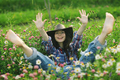 Happy American woman in wild flowers Royalty Free Stock Photos