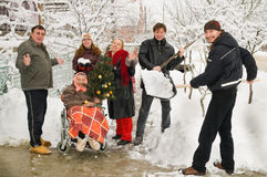 Happy amicable family. The big amicable family on the eve of Christmas rejoices to the first snow stock image