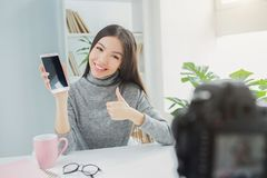 Free Happy And Cool Blogger Is Showing The Phone To The Vlogging Camera. She Likes Her New Present. Young Woman Is Showing Stock Photography - 113744712