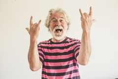 Free Happy And Crazy Senior Old Man With Rock`n Roll Hand Sign - Alternative Mature Caucasian Portait People Have Fun -youthful Retire Royalty Free Stock Photos - 163069168