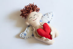Happy Angel. Happy Angel hugging red heart. Soft toy Stock Photography