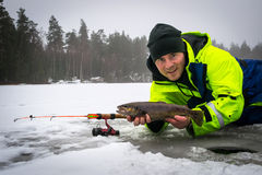 Happy angler with brown trout fishing trophy stock images