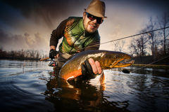 Happy angler with carp Stock Photography