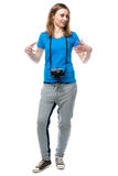 Happy animated young woman with a camera Royalty Free Stock Photography