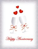 Happy anniversary. Card in red letters with two wine glasses and red hearts on white background with silver border / frame. For personal wedding event or royalty free illustration