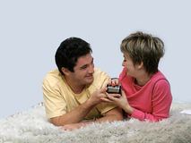 Happy anniversary. Young couple lying on the rug Stock Photo