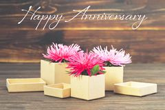 Happy Anniversary card with gift boxes and flowers royalty free stock photo