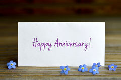 Happy anniversary card. And Love me not flowers Stock Images