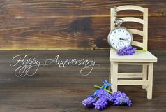 Happy Anniversary card with pocket watch and flowers stock image