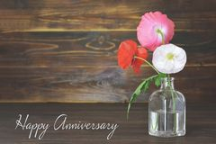 Happy Anniversary card with poppy flowers in vase. On wooden background stock images