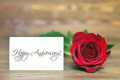 Happy Anniversary card. And red rose Royalty Free Stock Images