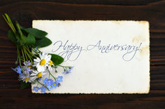 Happy Anniversary card. And spring flowers Stock Photography