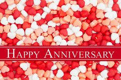 Happy Anniversary greeting on a candy hearts royalty free stock photos